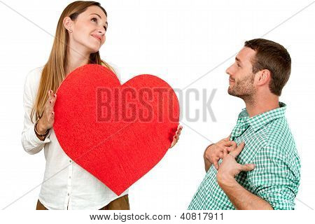Couple Fooling Around With Heart Sign.