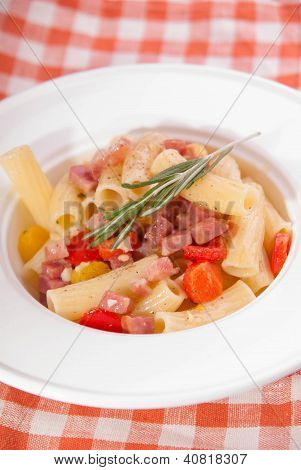 pasta with pancetta, red and yellow paprica and rosemary