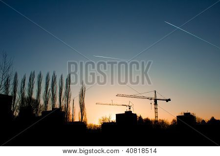 Freiburg Evening With Cranes And Planes