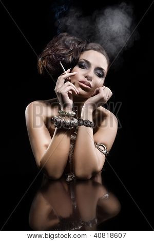 Beautiful Young Woman Smoking A Cigarette