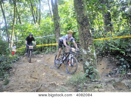 A Mountain Biker Chasing His Rival