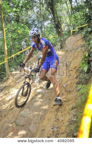 Mountain Bike Racer Pushing His Bicycle
