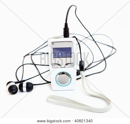 Mp3 player with headphones on white background