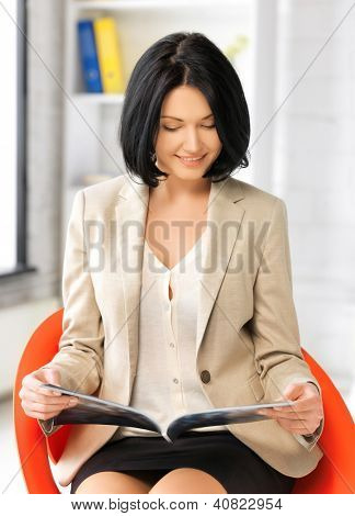 picture of attractive businesswoman with magazine.