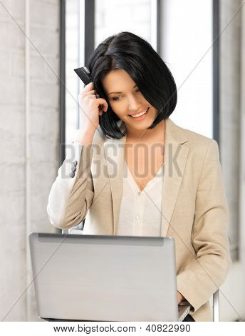 picture of happy woman with laptop computer and credit card.
