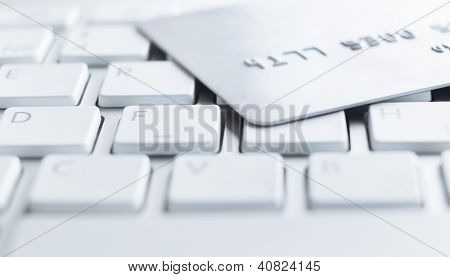 Close up of credit card on a computer keyboard. Concept of internet purchase
