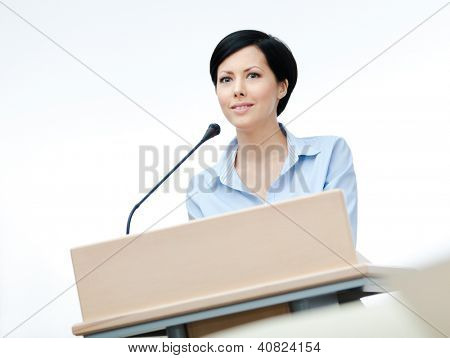 Female speaker at the podium. Business presentation