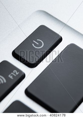 Close up of part of computer keyboard. Focus on power button