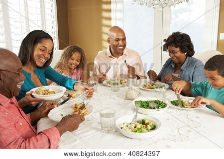 Multi Generation Family Enjoying Meal At Home