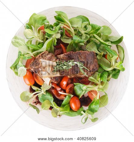 Rare fried rack of lamb isolated on white background, shot from above