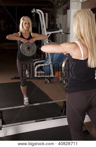 Woman Holding Weight In Mirror