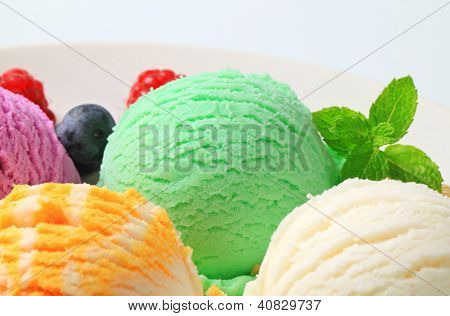 selection of ice cream with green scoop in the middle