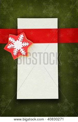 Christmas card with star cookie on fabric background