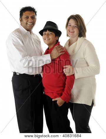Standing portrait of a happy biracial family of three -- an Asian Indian dad, caucasian mom and their preteen son.  On a white background.