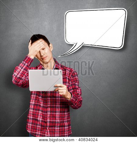 Asian man with speech bubble and touch pad in his hands embarrassed with news