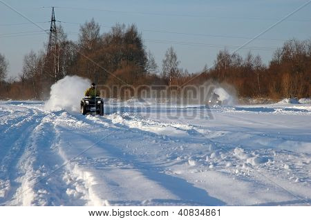 All Terrain Vehicle In Motion At Winter
