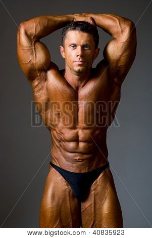 Bodybuilder Strong Athletic Man Show Muscle Arm