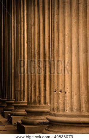 Tall old building pillars in sepia color