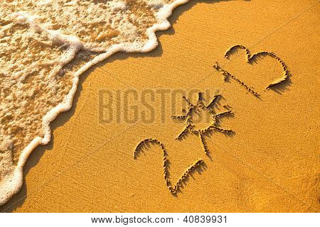 2013 written in sand on beach texture - soft wave of the sea.