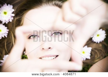 Portrait Of Young Woman Creates A Frame With Her Hands