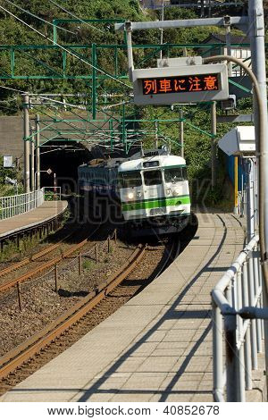 Kasashima Japan Oct 23 2010-Train Arriving At Rural Japanese Station.