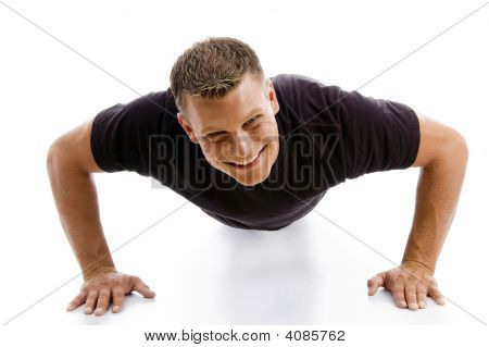 Smiling Muscular Male Doing Push Ups