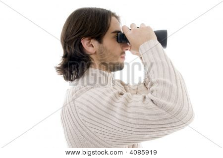 Side Pose Of Young Man Watching Through Binocular