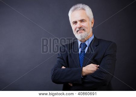 Business man smiling with arms crossed