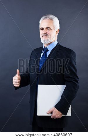 Handsome business man showing thumbs up sign