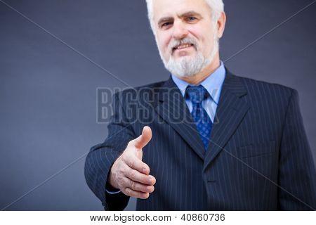 Business man offering for handshake