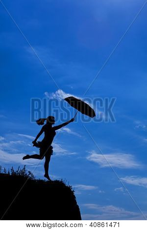 silhouette of girl flight with umbrella