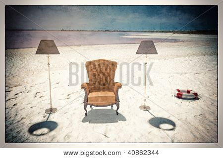 luxury leather armchair on the beach (vintage card style)