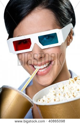 Viewer in 3D spectacles drinking beverage and eating popcorn, isolated on white