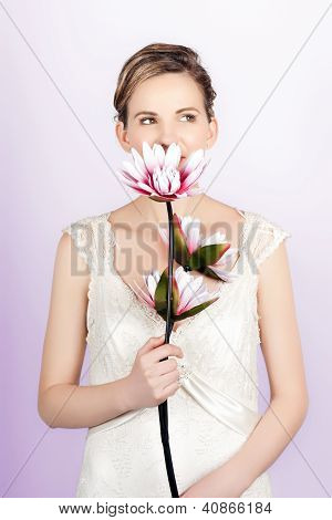 Young Romantic Woman With Lotus Flowers