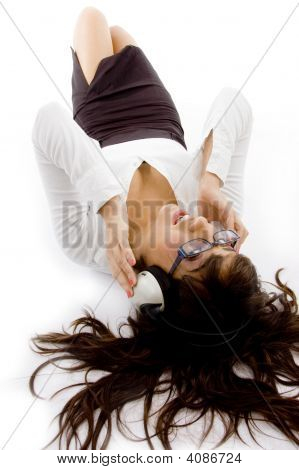 High Angle View Of Young Attorney Listening Music On Headset