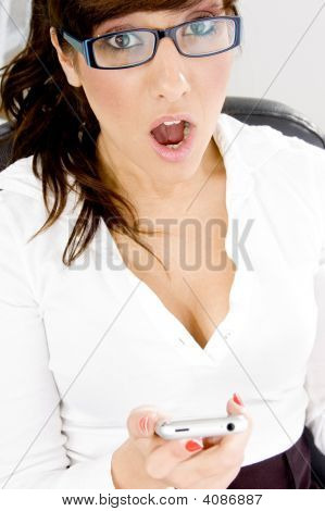 High Angle View Of Shocked Businesswoman After Attending A Call