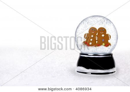 2 Happy Gingerbread People Inside A Snowglobe
