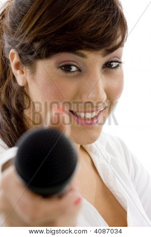 Front View Of Female Executive Offering Mic To Sing