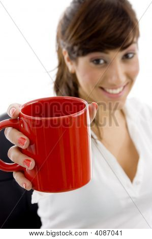 Front View Of Smiling Female Executive Holding Coffee Mug