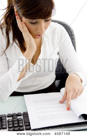 Front View Of Shocked Female Executive Reading A Document