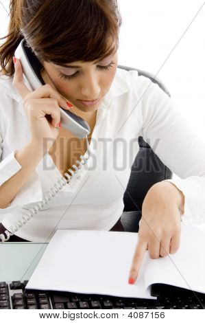 Front View Of Female Attorney Attending Phone Call And Reading Agreement