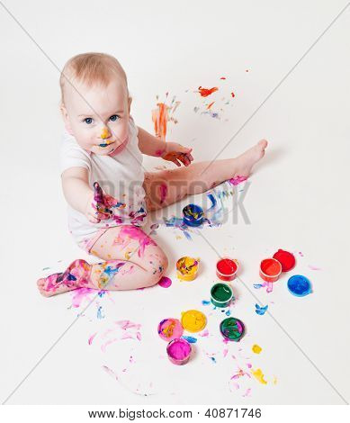 year-old child playing with paints