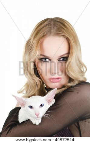 beauty young blond woman with oriental shorthair cat on a white