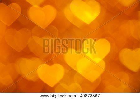 golden hearts bokeh as background