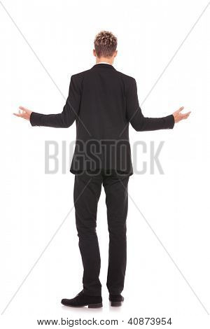 full body back view of a business man welcoming you on white background