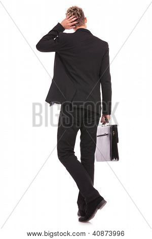 Rear view of a business man thinking, isolated on white background