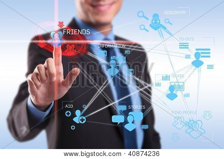 business man pushing the friends button on a social network application screen