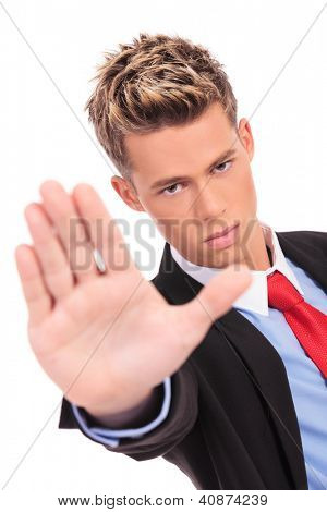 serious business man showing stop gesture on white background