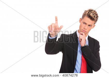 pensive young business man pushing an imaginary button