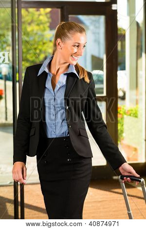 Businesswoman arriving at Hotel with her suitcases